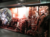 Large panel showing a nazi march-past